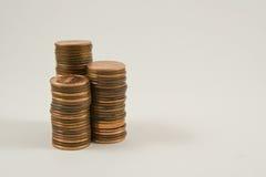 Pilhas de moedas de um centavo Foto de Stock