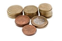Pilhas de moedas do euro e dos centavos Imagem de Stock