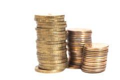 Pilhas de moedas douradas Foto de Stock Royalty Free