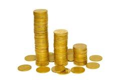 Pilhas de moedas douradas. fotos de stock royalty free