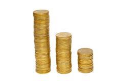 Pilhas de moedas douradas. fotografia de stock