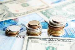 Pilhas de moedas misturadas Imagem de Stock