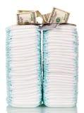Pilhas de tecidos e dólares isolados no fundo branco Imagens de Stock