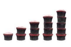 Pilhas diferentes de queques Imagens de Stock