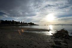 Pilier à la plage Vancouver de Kitsilano de coucher du soleil Images stock