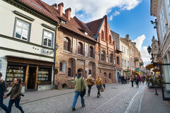 Pilies street. VILNIUS, LITHUANIA - SEPTEMBER 26: Tourists visit one of the most popular Pilies street of the old town on September 26, 2014 in Vilnius Stock Images