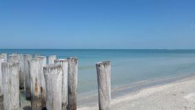 Pilings on Naples Beach Royalty Free Stock Image