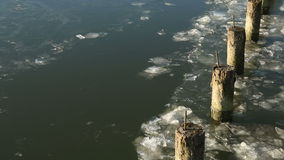 Pilings and River Ice Flow stock video