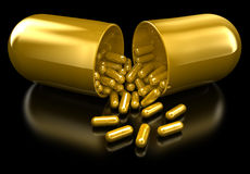 Pill. Golden pill with even more golden pills inside Stock Photography