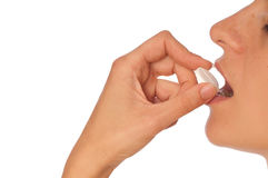 Pill. Woman taking narcotic in a shape of white pill Royalty Free Stock Image