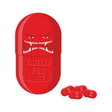 Pill of anger. Red Tablet with a scary face. Medicine with for f Stock Images