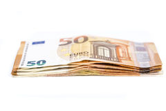 Pill of Bill paper 50 euro banknotes on white background Royalty Free Stock Photo