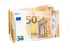 Pill of Bill paper 50 euro banknotes on white background Stock Images