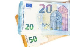 Pill of Bills paper 20 and 50 euro banknotes on white background Royalty Free Stock Photography