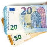 Pill of Bills paper 20 and 50 euro banknotes on white background Stock Image