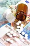 Pill Bottle. Open pill bottle on Euro Notes stock photo