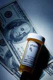 Pill Bottle and dollar Royalty Free Stock Photo