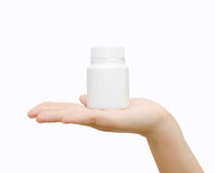 Pill bottle on hand Royalty Free Stock Photo