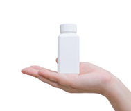 Pill bottle on hand Stock Photos