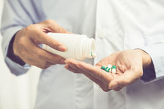 Pill bottle in male doctor hands Royalty Free Stock Image