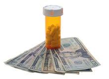 Pill bottle money. Pill bottle with money isolated on white Stock Photos