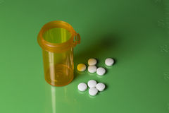Pill Bottle and Pills on a Green Scaled Slab Stock Image