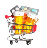 Pill bottle and pills in shopping cart isolated. Concept. Pharmacy. Pill bottle and pills in shopping cart isolated on white. Concept. Pharmacy Stock Images