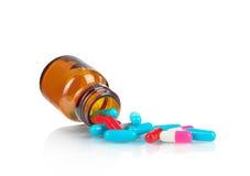 Pill bottle Pills spilling Royalty Free Stock Image