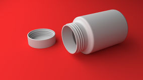 Pill bottle on red background Stock Photo