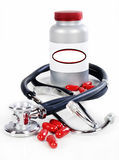 Pill bottle, red pills and a stethoscope Royalty Free Stock Photography