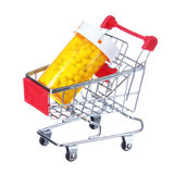 Pill bottle in shopping cart isolated. concept royalty free stock photography
