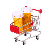 Pill bottle in shopping cart isolated on white background Stock Images