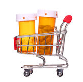 Pill bottle in shopping cart isolated on white background Royalty Free Stock Image