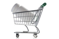 Pill bottle in shopping cart isolated on white Stock Image