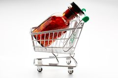 Pill bottle in shopping cart trolley Royalty Free Stock Photos