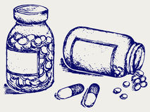 Pill bottle. Spilling pills on to surface Stock Photography