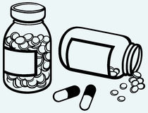 Pill bottle. Spilling pills on to surface Royalty Free Stock Photography