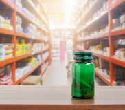 Pill bottle on table with pharmacy store Stock Image