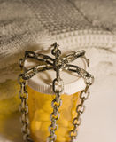 Pill bottle wrapped in chains Stock Images