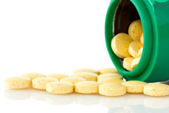 Pill bottle with yellow pills Stock Photography