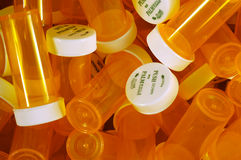 Pill Bottles. A large number of amber prescription pill bottles Stock Photography