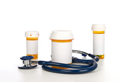 Pill bottles with blank labels and stethoscope Stock Images
