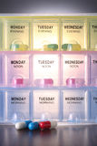 Pill box. Clocse up of the daily pill box Royalty Free Stock Photos