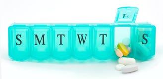 Pill Box. A macro shot of a green pill box over a white background Stock Photos