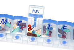 Pill box for medication. An isolated pill box used to store medicine and remind one of their daily dosage to take their perscription Royalty Free Stock Photo