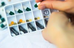 Daily pill box stock photo
