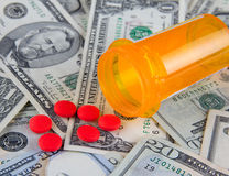 Pill box and pills on dollars. Healthcare expenses in america - pills on US dollar bills Royalty Free Stock Photography
