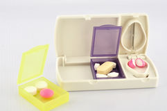 Pill box and split blade tablet. Pill box and split blade show medicine concept Royalty Free Stock Photos