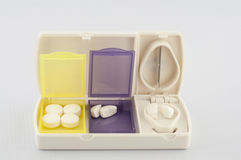 Pill box and split blade tablet Royalty Free Stock Photography