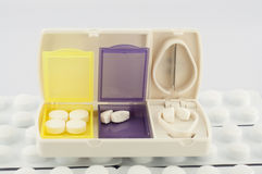 Pill box and split blade tablet Royalty Free Stock Photos